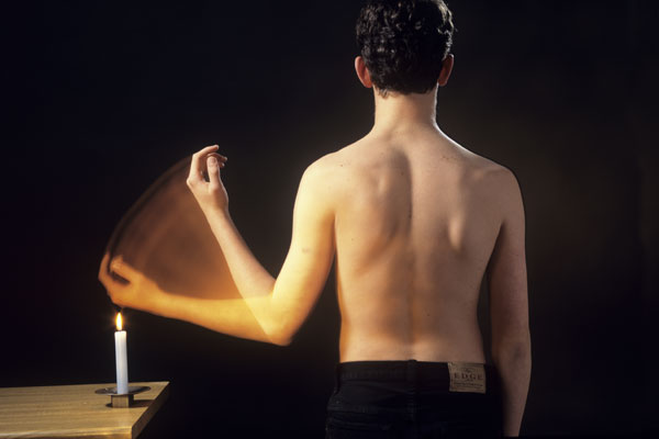 For most people, pain is an automatic reflex that protects them from damaging stimulus like a hot stove or candle. For example, heat exposure activates pain receptors in the skin, which pass a signal along a sensory neuron to the spinal cord. This activates a motor neuron, which sends a signal to the muscles in the arm, causing it to contract. But nerve damage can send false signals that cause real pain, or prevent individuals from feeling pain when they are injured.