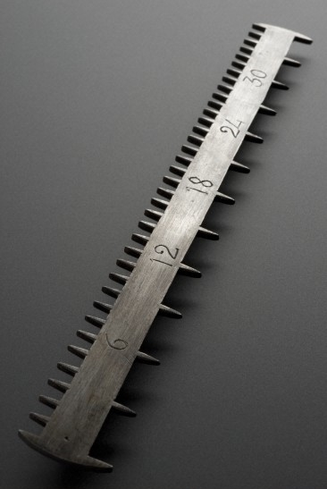 This pill cutter was used by pharmacists to equally divide drugs in the 18th century. Reports from the time vary on it's efficacy as a hair comb.