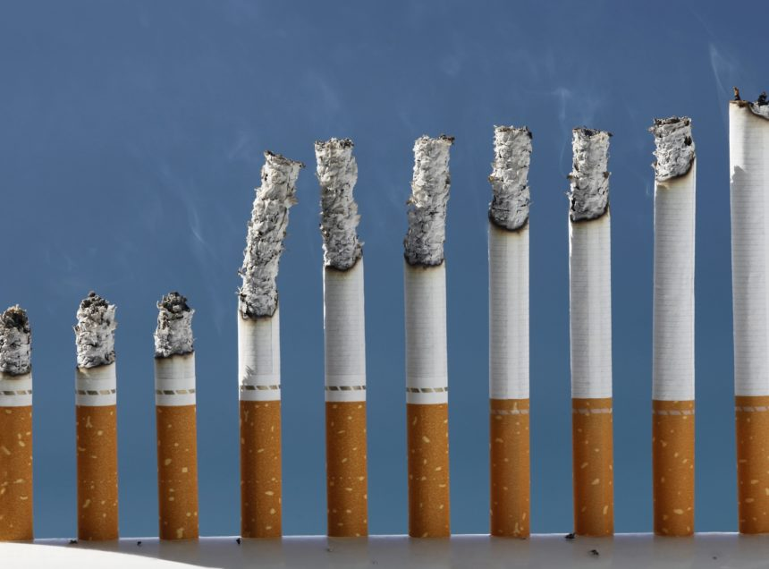 a row of lit cigarettes