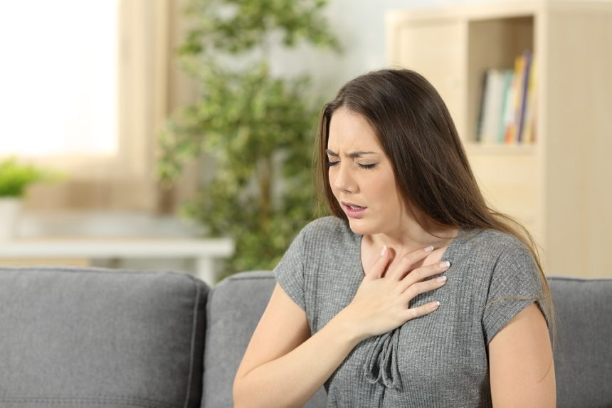 Woman suffering with respiratory issues, chest pain